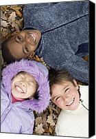 10:7 Canvas Prints - Smiling Children Lying On Autumn Leaves Canvas Print by Ian Boddy