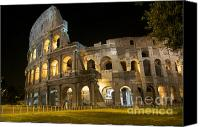 Ruin Canvas Prints - Coliseum illuminated at night. Rome Canvas Print by Bernard Jaubert