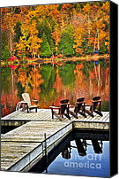 Tranquil Canvas Prints - Wooden dock on autumn lake Canvas Print by Elena Elisseeva