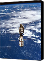 Challenge Canvas Prints - A Satellite Orbiting Above The Earth Canvas Print by Stockbyte