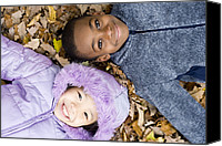 Multicultural Canvas Prints - Smiling Children Lying On Autumn Leaves Canvas Print by Ian Boddy