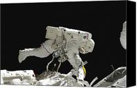 Exposed Canvas Prints - Astronaut Working On The International Canvas Print by Stocktrek Images