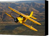 Aircraft Photo Canvas Prints - A Beechcraft D-17 Staggerwing In Flight Canvas Print by Scott Germain