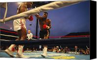 Athletes Canvas Prints - A Boxer Delivers A Punch Canvas Print by Maria Stenzel