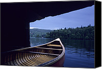 Fun Houses Canvas Prints - A Canoe Sticks Out Of A Boathouse On An Canvas Print by Taylor S. Kennedy