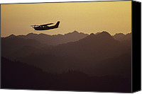 Disasters Canvas Prints - A Cessna 210 Soars Above Olympic Canvas Print by Joel Sartore
