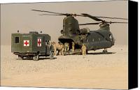 Afghanistan Canvas Prints - A Ch-47 Chinook Helicopter Drops Canvas Print by Andrew Chittock