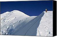 Success Photo Canvas Prints - A Climber Ascends A Snow Covered Canvas Print by Gordon Wiltsie