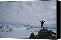 Gesturing Canvas Prints - A Climber Raises His Arms In Triumph Canvas Print by John Burcham