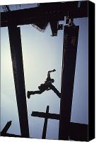 Etc. Canvas Prints - A Construction Worker Jumps From Girder Canvas Print by Lynn Johnson