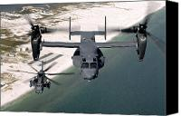 Aircraft Photo Canvas Prints - A Cv-22 Osprey And An Mh-53 Pave Low Canvas Print by Stocktrek Images