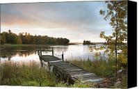 Serene Canvas Prints - A Dock On A Lake At Sunrise Near Wawa Canvas Print by Susan Dykstra