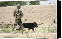 Foot Patrol Canvas Prints - A Dog Handler Of The U.s. Marine Corps Canvas Print by Stocktrek Images