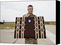 Merit Photo Canvas Prints - A German Soldier Holds A Display Canvas Print by Terry Moore