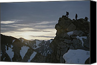 Success Photo Canvas Prints - A Group Of Climbers Silhouetted Atop Canvas Print by George F. Mobley