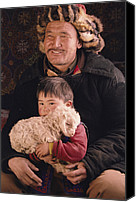 Families Canvas Prints - A Kazakh Eagle Hunter And His Son Canvas Print by David Edwards