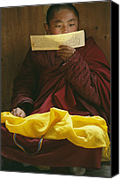 Religious Structures Canvas Prints - A Lama Studies Tibetan Scripture Canvas Print by David Edwards