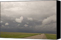 Thunderclouds Canvas Prints - A Lone Car Travels Down A Rural Highway Canvas Print by Phil Schermeister