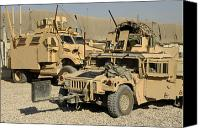 M1114 Canvas Prints - A M1114 Humvee Sits Parked In Front Canvas Print by Stocktrek Images