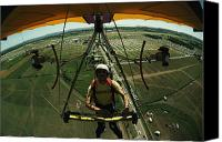 Appearance Canvas Prints - A Man Flies In A Hang Glider Powered Canvas Print by James A. Sugar