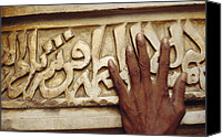 Religious Structures Canvas Prints - A Man Runs His Hand Over Arabic Script Canvas Print by Justin Guariglia