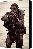 Navy Seals Canvas Prints - A Navy Seal Exits The Water Armed Canvas Print by Michael Wood