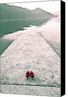 Shoes Canvas Prints - A Pair Of Red Womens Shoes Lying On A Walkway That Leads Into A Canvas Print by Joana Kruse