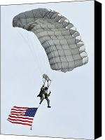 Commemorating Canvas Prints - A Parachutist Flies The American Flag Canvas Print by Stocktrek Images