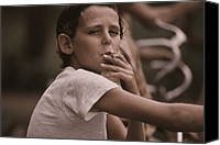 Addictions Canvas Prints - A Pre-teen Boy Smoking A Cigarette Canvas Print by Everett