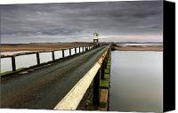 Sand Fences Canvas Prints - A Road Going Over Water Towards A Beach Canvas Print by John Short