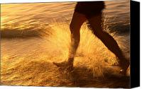 Surf Lifestyle Canvas Prints - A Runner Splashing Through The Surf Canvas Print by Phil Schermeister