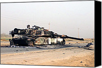 Iraq Canvas Prints - A Scuttled Abrams Tank Rests In Front Canvas Print by Everett
