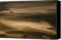 Bi Planes Canvas Prints - A Small Airplane Flies Through A Cloudy Canvas Print by Raul Touzon