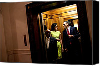 Michelle Obama Canvas Prints - A Smiling President Obama Holds Canvas Print by Everett