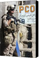 Foot Patrol Canvas Prints - A Soldier Provides Security Canvas Print by Stocktrek Images