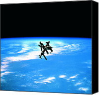 Astronomy Canvas Prints - A Space Station In Orbit Above Earth Canvas Print by Stockbyte