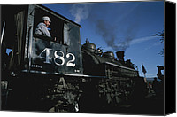 Rail Vehicles Canvas Prints - A steam engine engineer Canvas Print by National Geographic