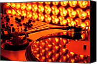 Shiny Photo Canvas Prints - A Turntable And Sound Mixer Illuminated By Lighting Equipment Canvas Print by Twins