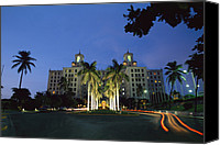 Twilight Views Canvas Prints - A Twilight View Of Building With Palm Canvas Print by Steve Winter
