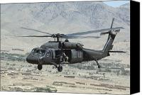 Aircraft Photo Canvas Prints - A Uh-60 Blackhawk Helicopter Canvas Print by Stocktrek Images