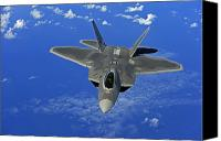 Aircraft Photo Canvas Prints - A U.s. Air Force F-22 Raptor In Flight Canvas Print by Stocktrek Images