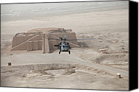 Second Gulf War Canvas Prints - A Us Army Black Hawk Helicopter Hovers Canvas Print by Everett