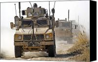 Dirt Roads Photo Canvas Prints - A U.s. Army M-atv Leads A Convoy Canvas Print by Stocktrek Images