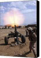 Gunfire Canvas Prints - A U.s. Marine Corps Gunner Fires Canvas Print by Stocktrek Images