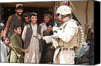 Insurgency Canvas Prints - A U.s. Marine Talks With Afghans Canvas Print by Everett