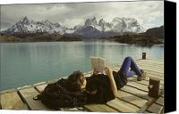 Appearance Canvas Prints - A Woman Relaxes On A Dock While Reading Canvas Print by Skip Brown