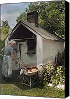 Pennsylvania Dutch Canvas Prints - A Woman Takes Bread From An Outdoor Canvas Print by J. Baylor Roberts