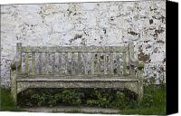 Park Benches Photo Canvas Prints - A Wooden Bench With Peeling Paint Canvas Print by John Short
