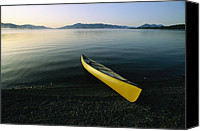 Chromatic Contrasts Canvas Prints - A Yellow Canoe On The Shore Of A Calm Canvas Print by Michael Melford