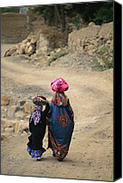 Dirt Roads Photo Canvas Prints - A Yemeni Woman And Child Carrying Canvas Print by Michael Melford